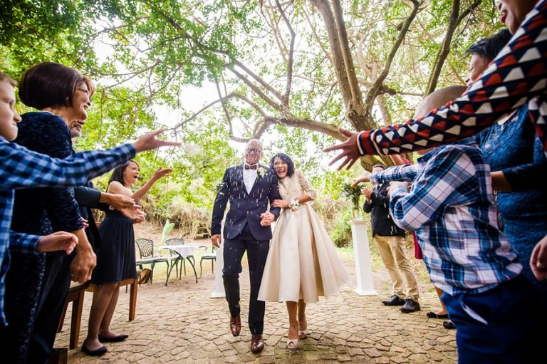 The just married couple gets showered by their intimate group of guests