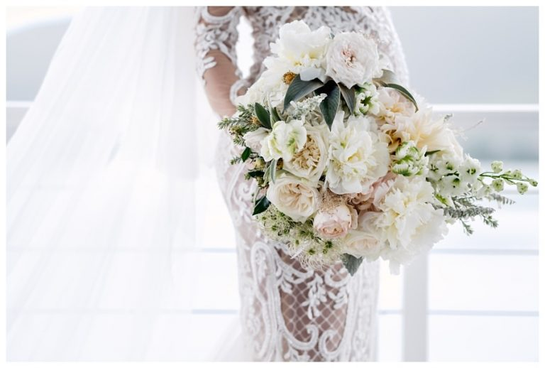 Tsala Wedding with the bride's gorgeous wedding bouquet is a sea of soft pinks and white
