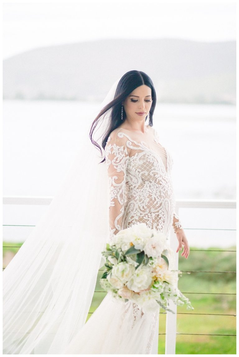 A soft bridal portrait of whites with the brides hair waving in the wind