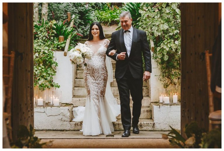 the beautiful bride to be with her father walking her down the isle