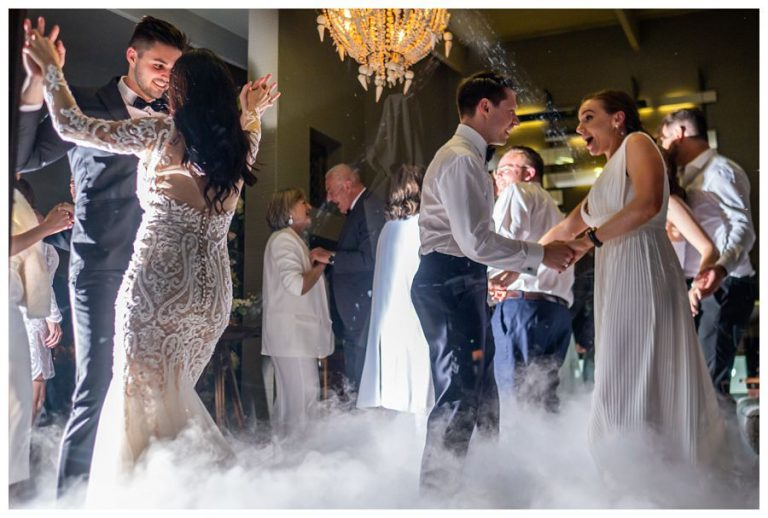the wedding guests joins the bridal party on the dance floor