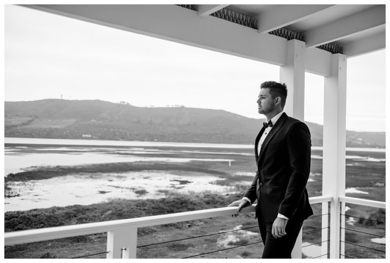 Tsala Wedding where the groom looks out onto the swamp lands for this groom portrait