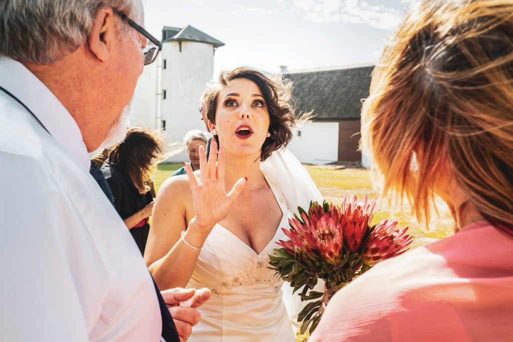 the bride tells a funny story to some of her wedding guests