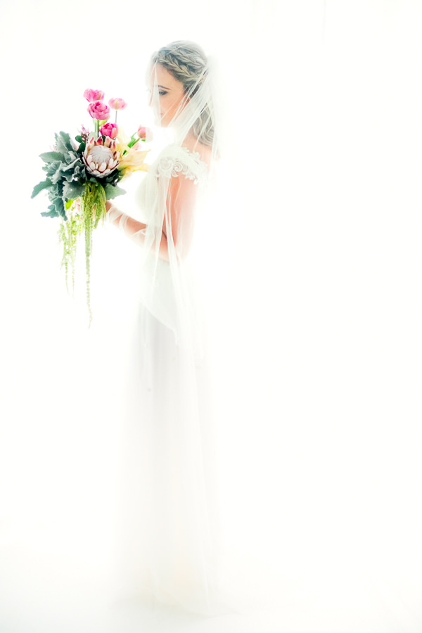 a fine art bridal portrait in white