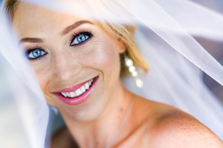 a portrait of a bride with bright blue eyes