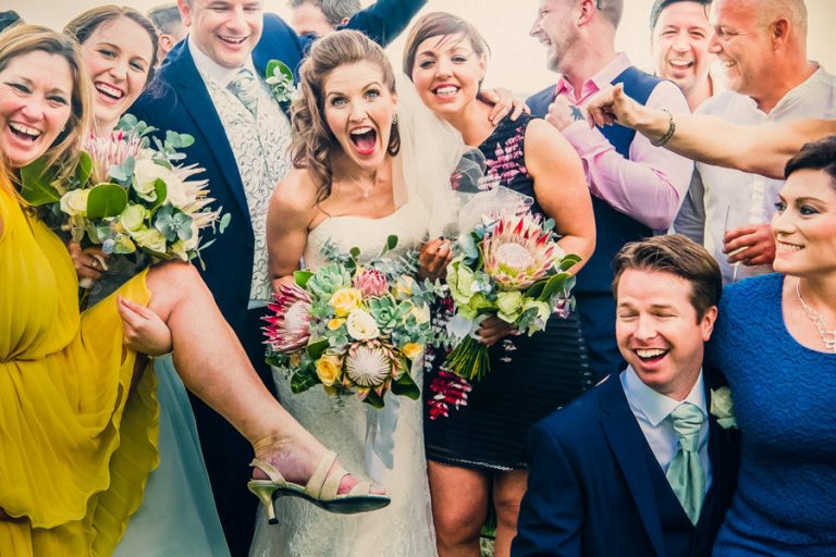 a comical photo of the bride and groom and their wedding guests