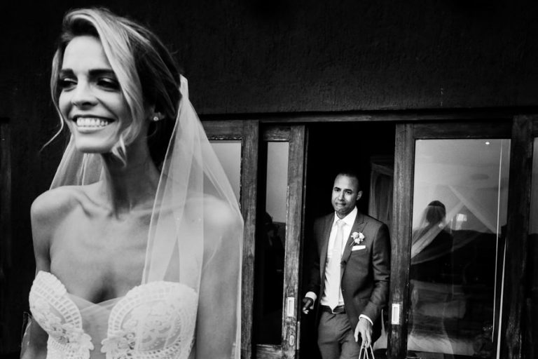 an emotional groom sees his bride for the first time