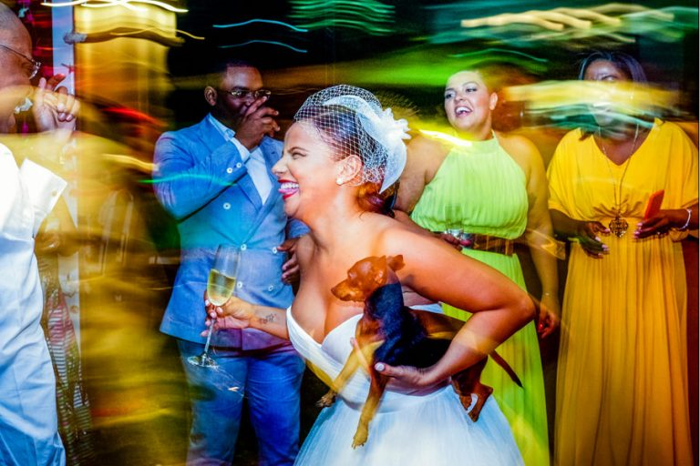 a fun dance floor shot with the bride and her dog
