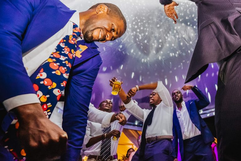 the groom and his groomsmen doing a dance off