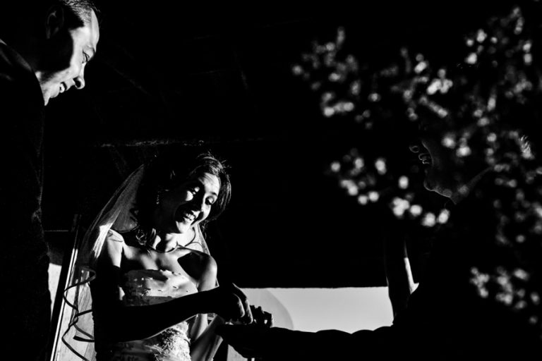 a black and white photo of a funny moment during the ceremony