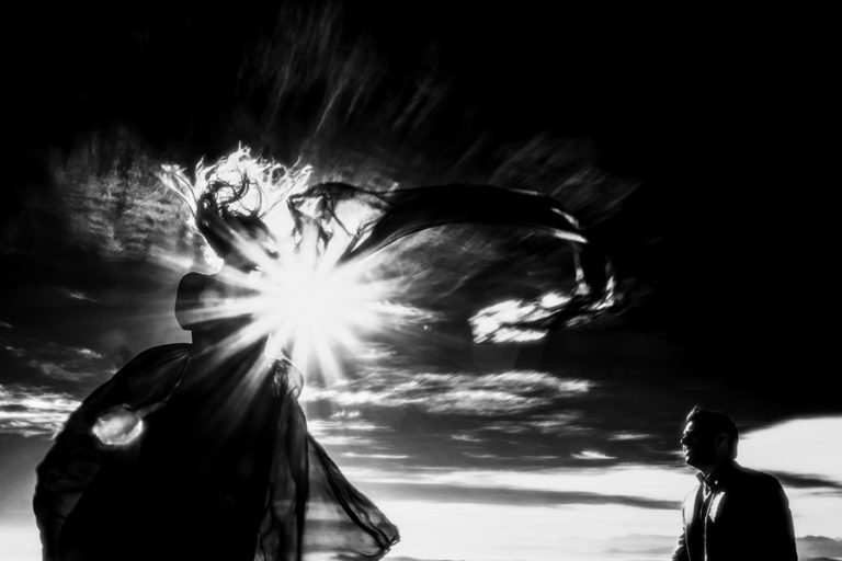 a very windy engagement photo in black and white