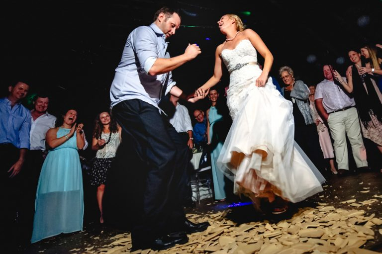 the newlyweds dance on the broken plates at this Greek wedding