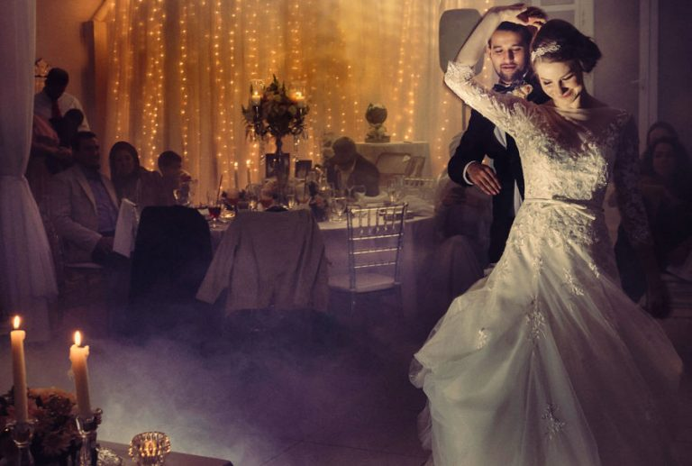 a romantic lighted photo of couple doing their first dance