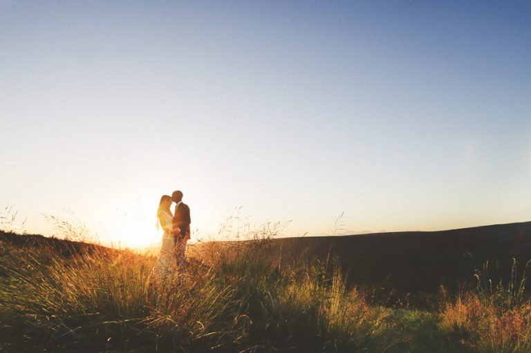 a soft romantic photo of the newlyweds in the African bush veld