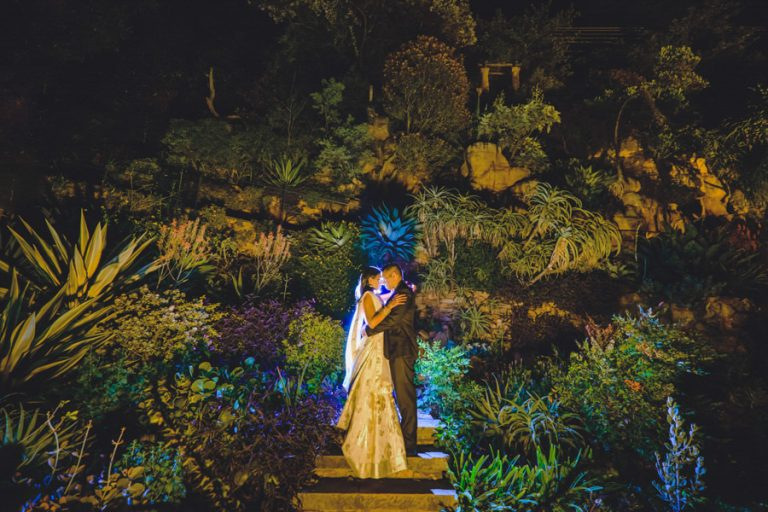 a night photo of the newlyweds using a sculpted garden
