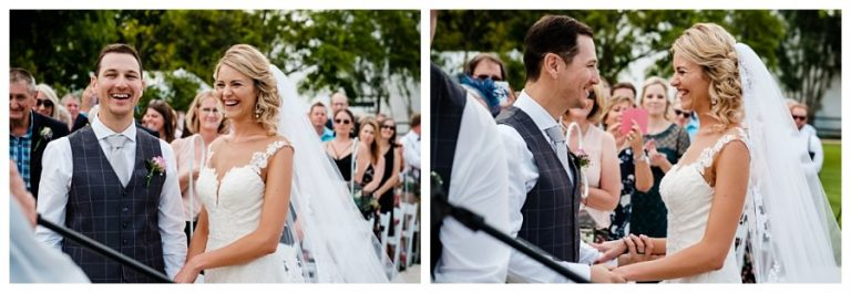the bridal couple shares a comical moment during the ceremony