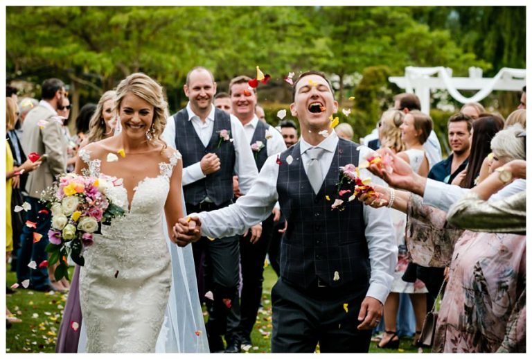 a comical moment from the groom while being showered by flowers