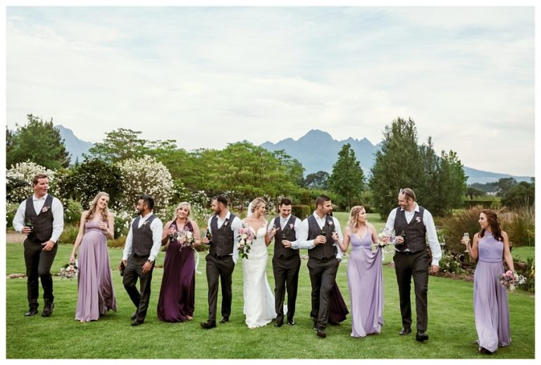 a wedding party walking and talking