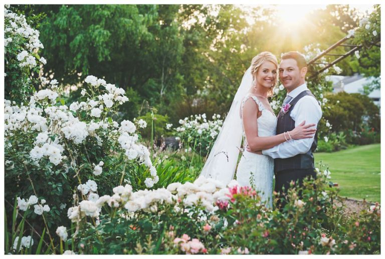 white roses and natural sunset light for this classical bridal portrait