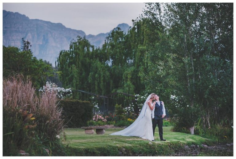 a couple portrait with green and mountain views