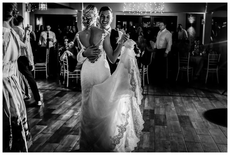 a black and white photo of the couple dancing