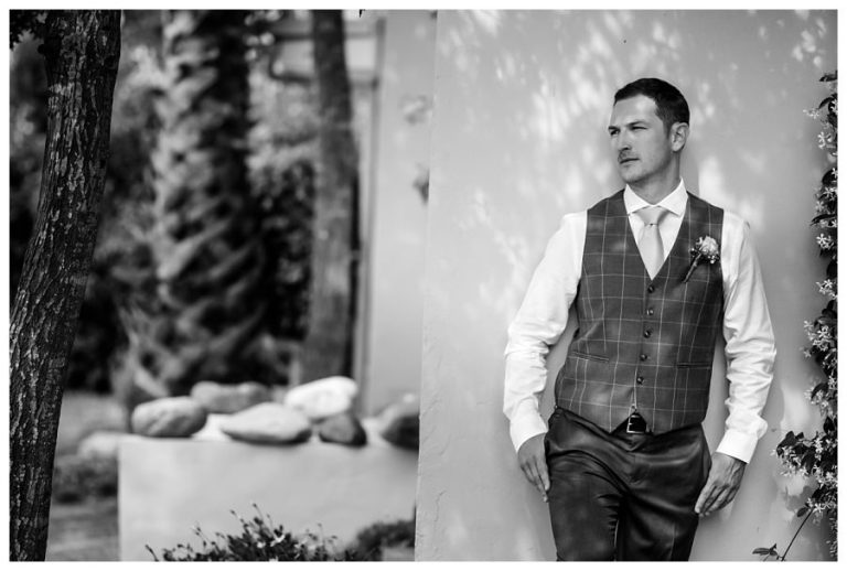 a black and white groom's portrait