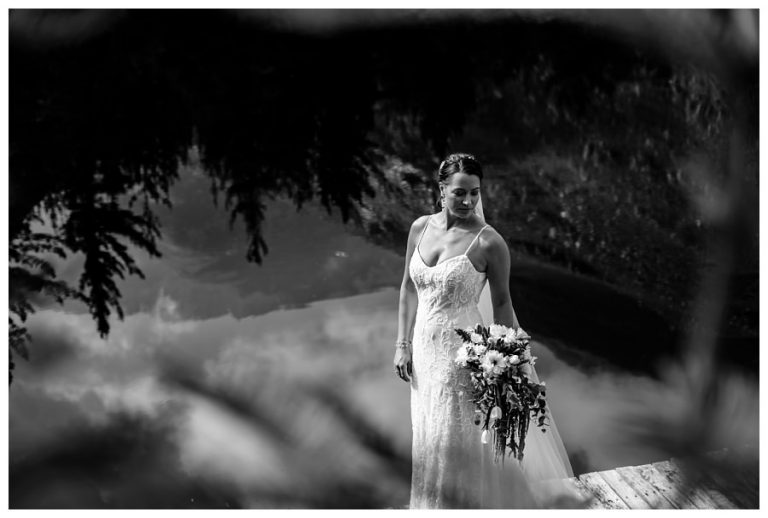 bride portrait with reflections of mountains and the lake