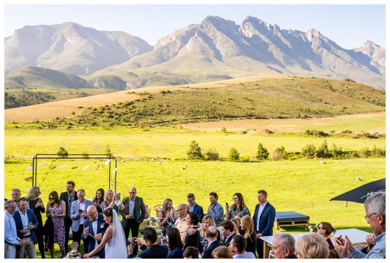 the bridal couple cut their cake with a spectacular view