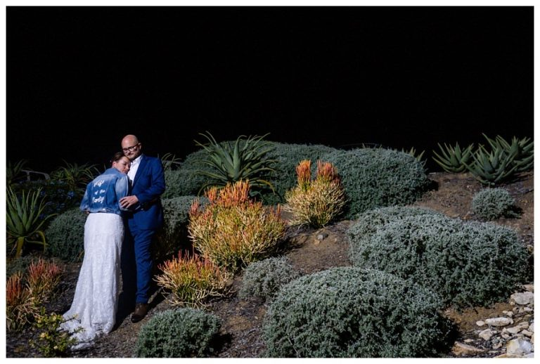 a night time wedding photo of the bridal couple