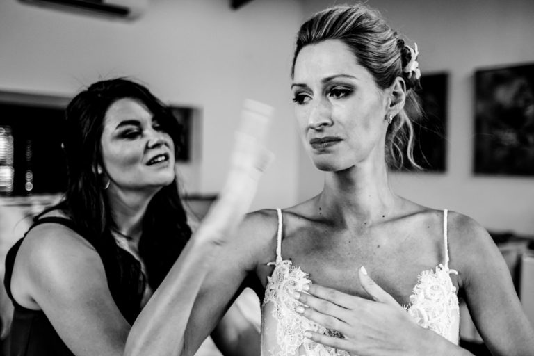 an emotional moment while the bride is getting ready