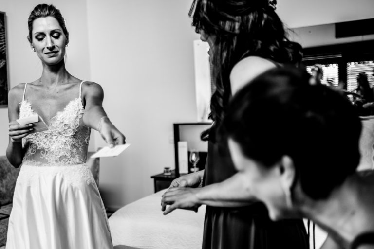 the sheds a tear while giving emotional letters to her bridesmaids