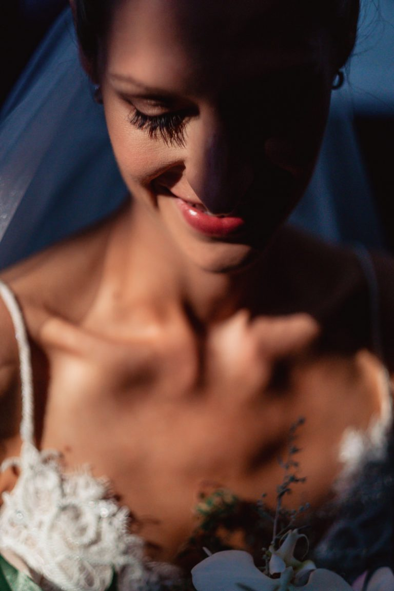 the natural light falls on the bride for this creative portrait
