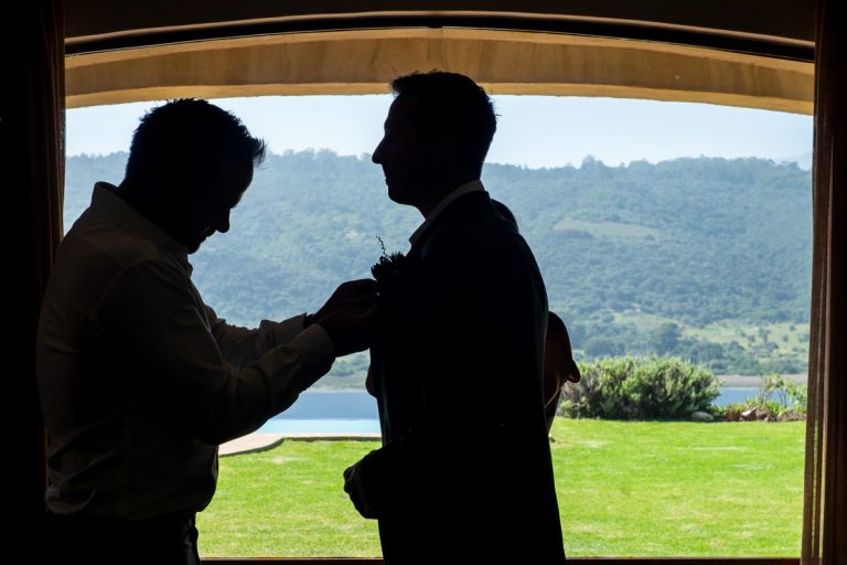 the groom does his wedding preparations with a beautiful view