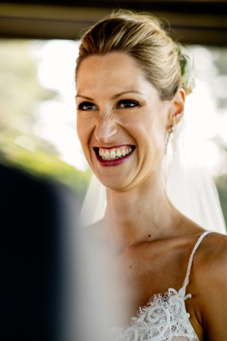 the bride having a laugh during the wedding ceremony