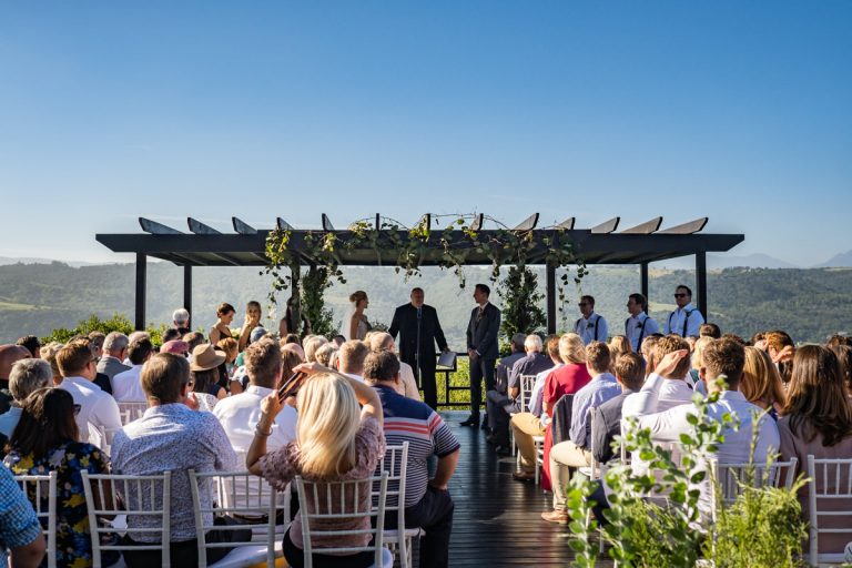 the wedding ceremony overlooking the view