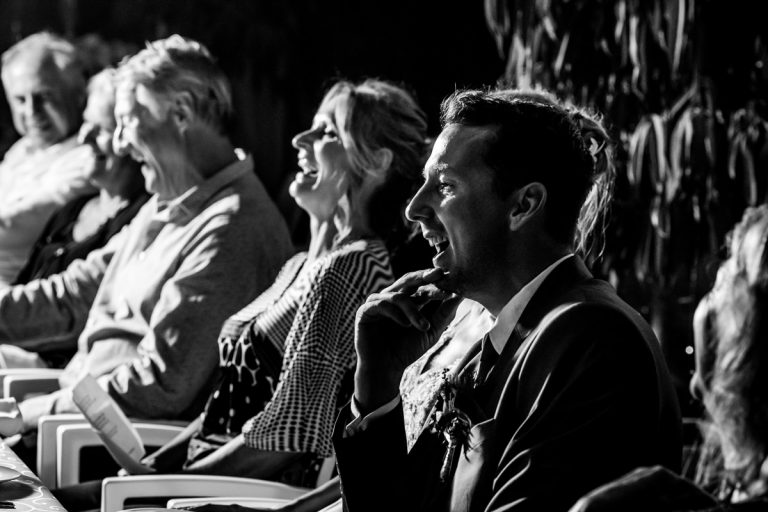 the groom reacts to a comical moment during their wedding speeches