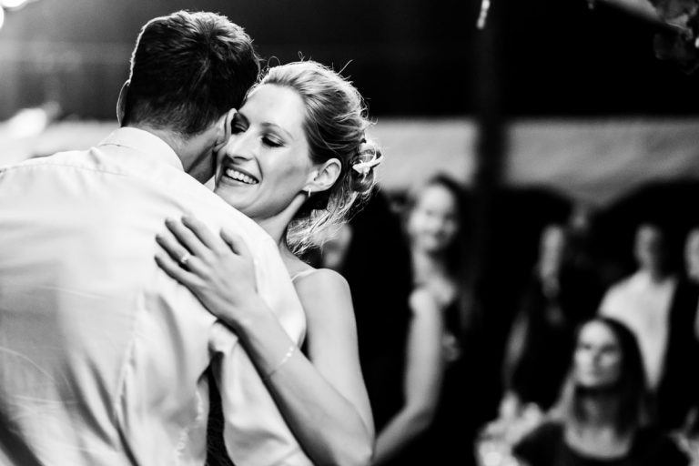 the bride and groom hugs while doing their first dance
