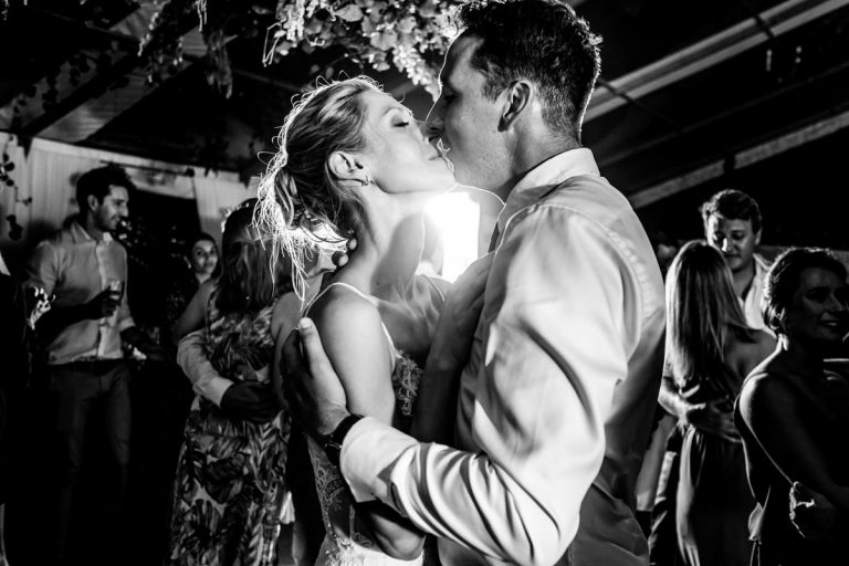 a kiss from the bride and groom