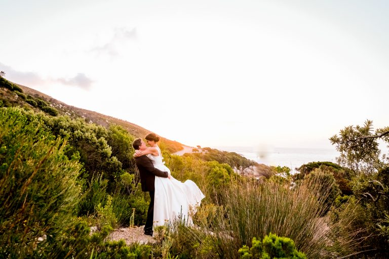 a landscape sunset photo of a happy wedding couple