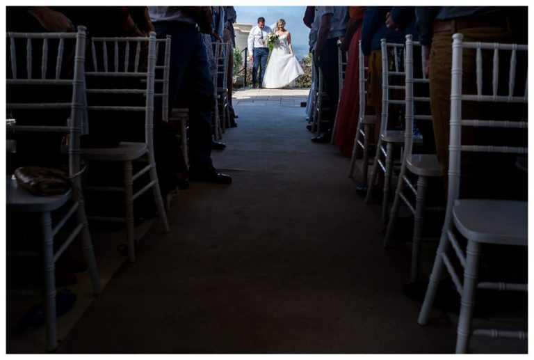 the bride walking down the isle with her brother