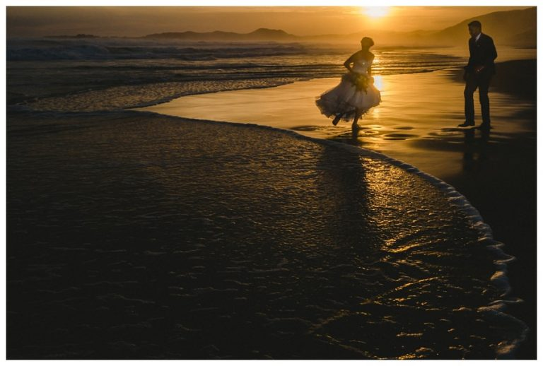 the bride runs away from a wave
